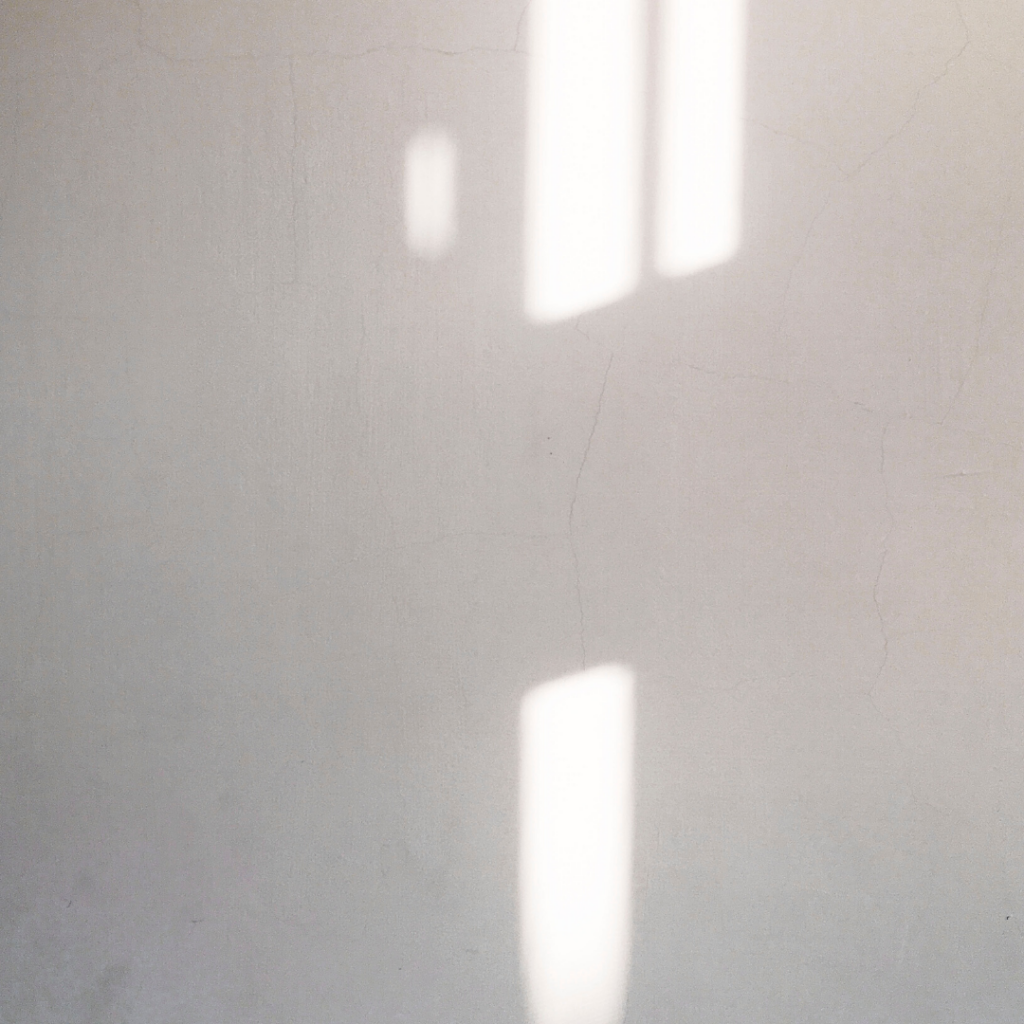 light through a window onto a white wall